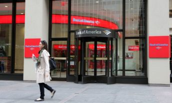 woman walking past bank of america - how to switch banks