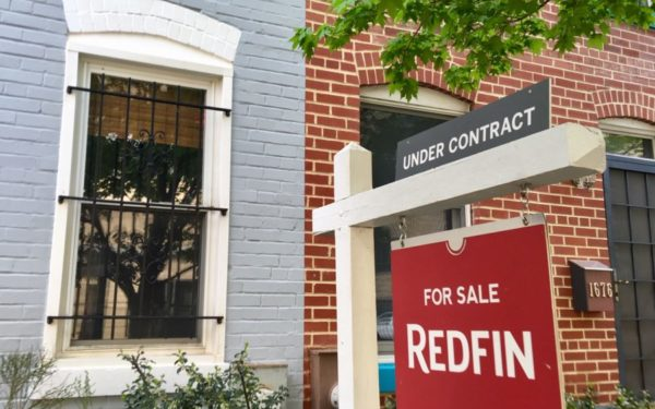 house for sale with redfin sign out front - can you buy a house with bad credit?