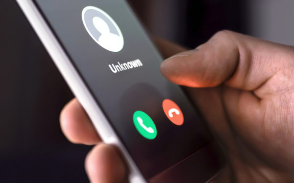 unknown caller on cell phone - debt relief scams