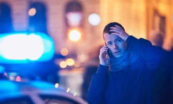 worried young man on phone after a car accident - what to do when your car insurance drops you