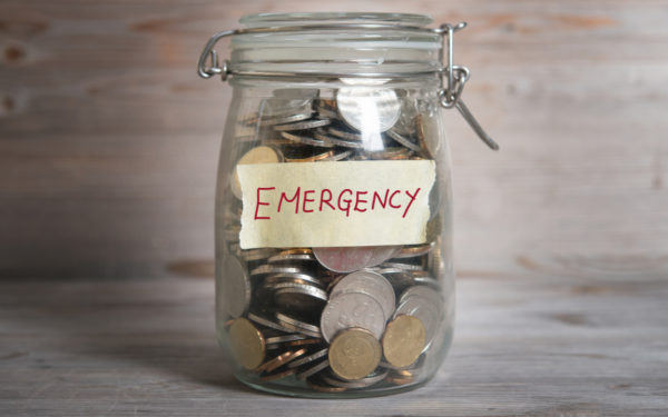 jar of coins labeled emergency fund