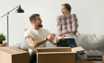 Couple unpacking boxes in their apartment
