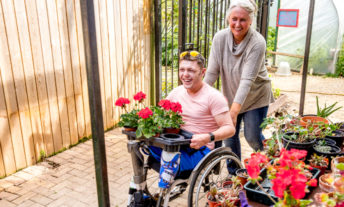 man and woman in wheelchair