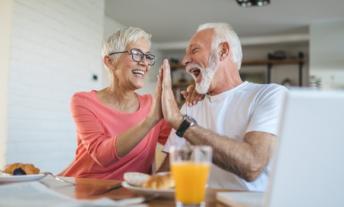 older renters high fiving
