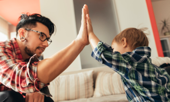 renter high fives son at home