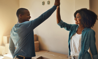 Renters high five in new apartment