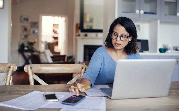 woman with glasses at laptop