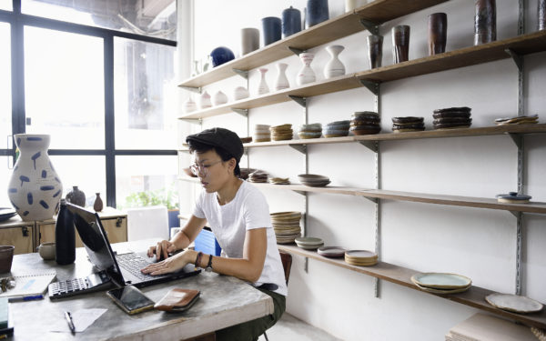 small business owner in front of a laptop