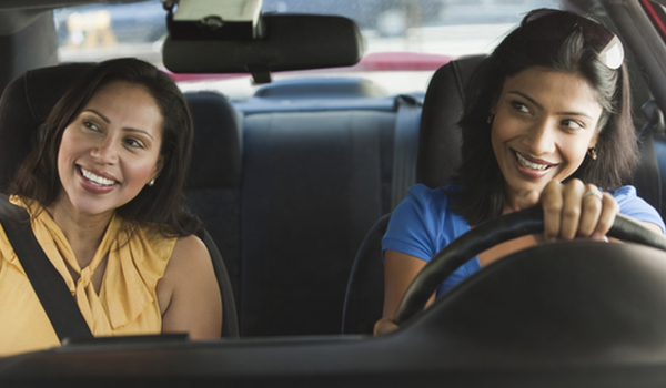 Two women driving in car