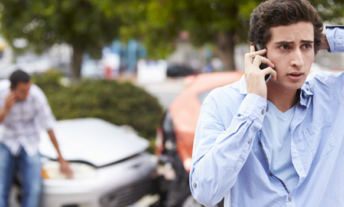 Guy talking on the phone after an accident