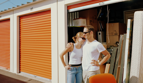 Couple standing outside of storage unit